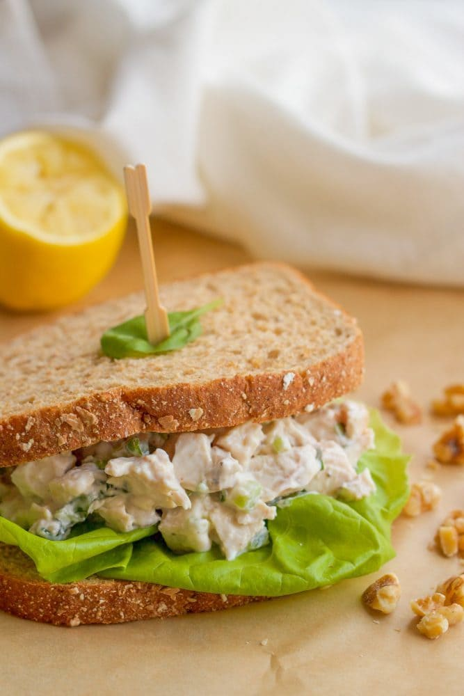 Healthy chicken salad sandwich with fresh basil and chopped walnuts, perfect for lunch! | FamilyFoodontheTable.com