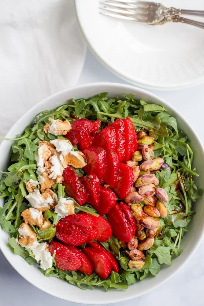 Baby arugula, strawberries, pistachios and goat cheese, all drizzled with an easy homemade balsamic vinaigrette! | FamilyFoodontheTable.com