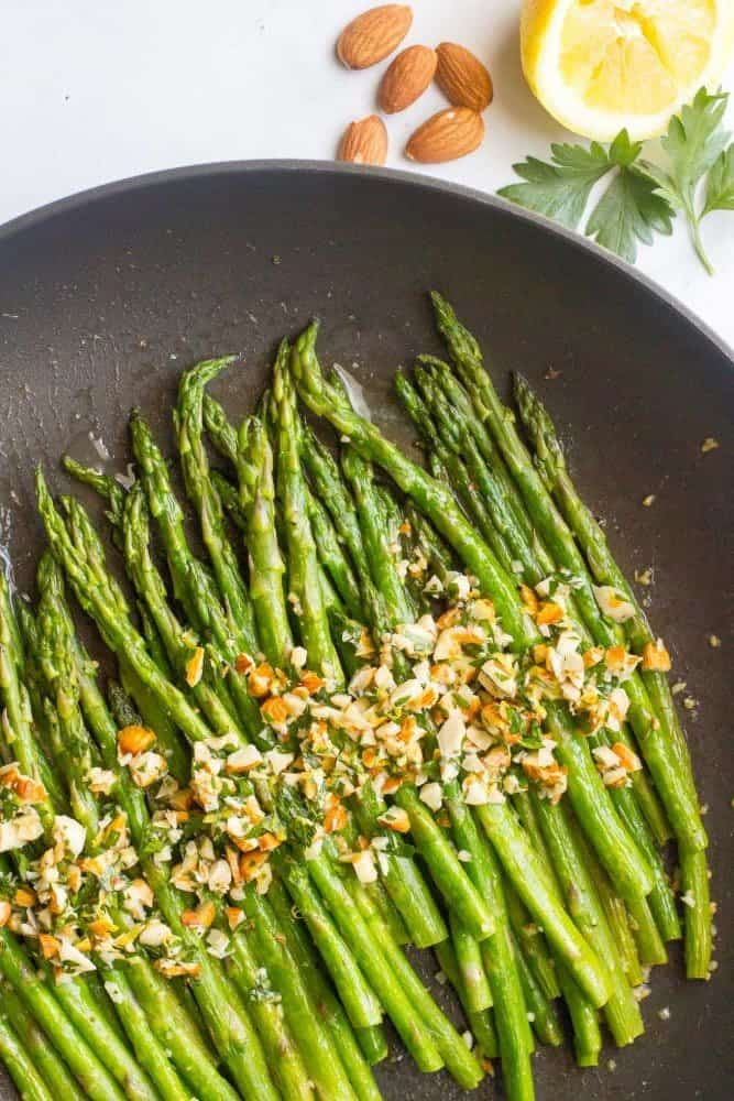 Asparagus almondine is an easy, healthy, 15-minute side dish that's sure to impress! The almondine mixture of almonds, butter, fresh herbs and lemon adds great flavor! #asparagus #sidedish #spring