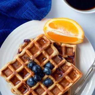 Whole wheat blueberry waffles with an orange maple syrup - a great easy breakfast or brunch recipe!