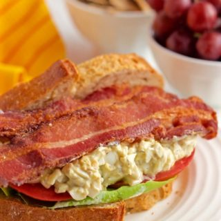 Creamy egg salad is paired with fresh tomatoes, soft Bibb lettuce and crispy strips of bacon for a stellar sandwich! | FamilyFoodontheTable.com