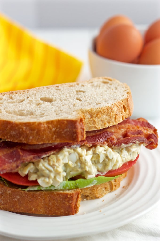 Creamy egg salad is paired with fresh tomatoes, soft Bibb lettuce and crispy strips of bacon for a stellar lunch sandwich!