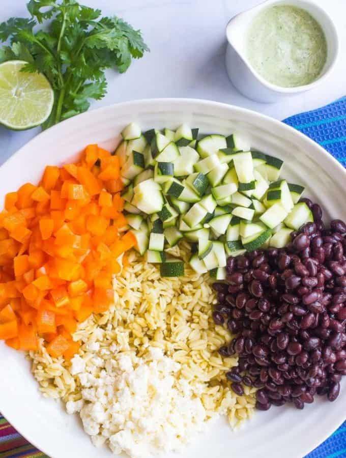 A cool, creamy southwestern orzo salad with an easy homemade cilantro-lime vinaigrette