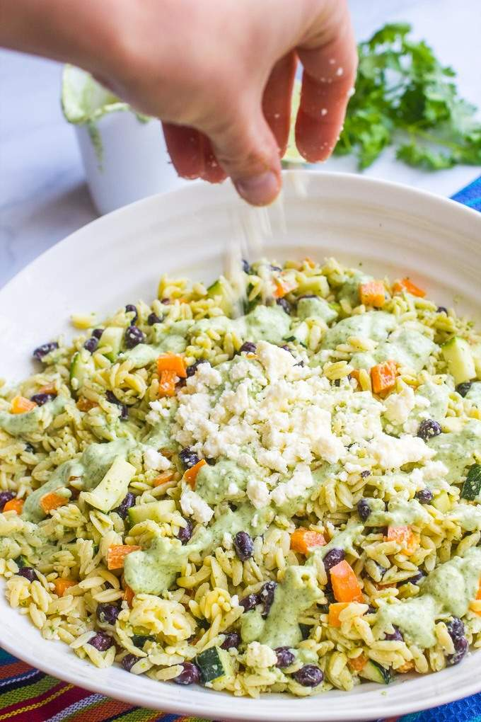 A cool, creamy southwestern orzo pasta salad with an easy homemade cilantro-lime vinaigrette