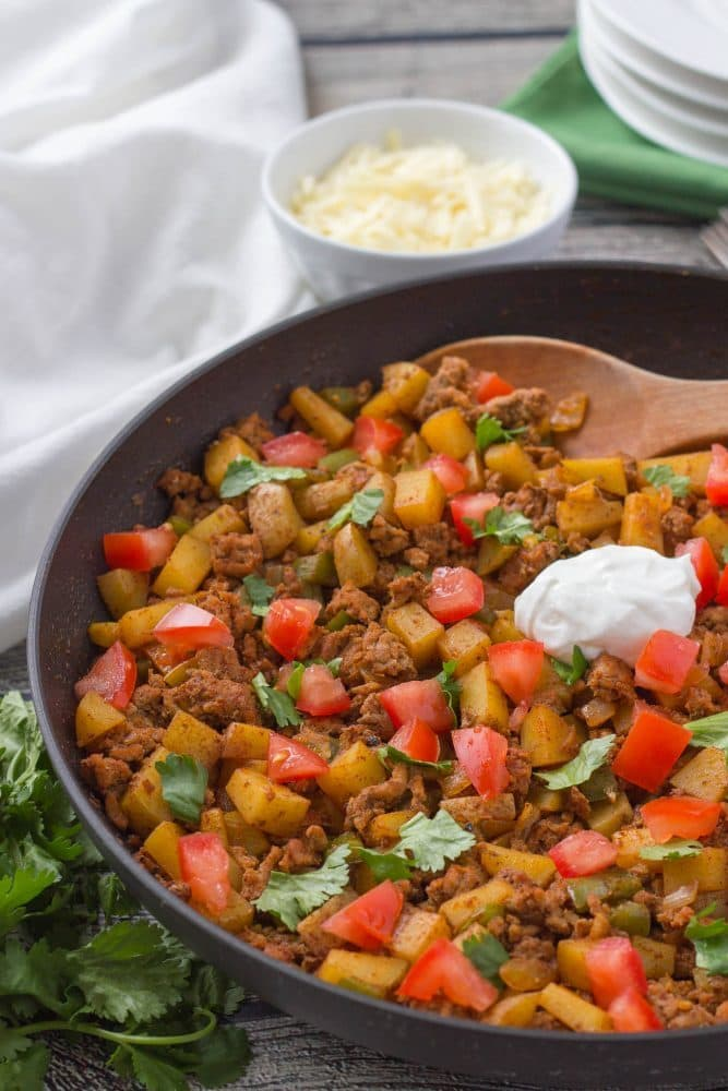 Easy, healthy ground turkey taco potato skillet - a one-pot dinner everyone will love! | www.familyfoodonthetable.com