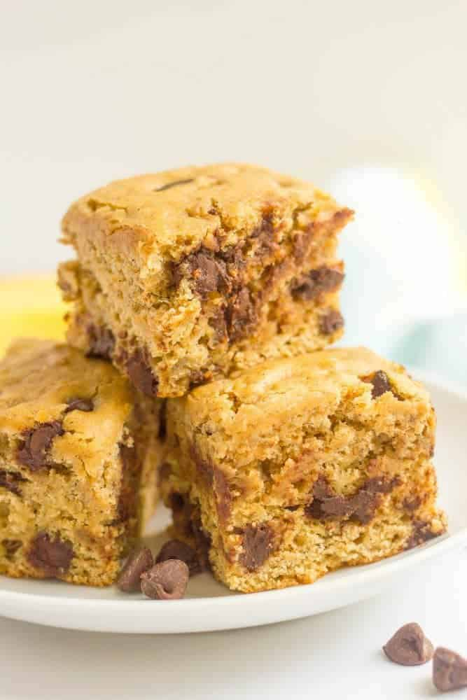 This easy banana chocolate chip snack cake is fluffy, moist and full of chocolate chips! It's whole wheat and naturally sweetened and makes a great sweet treat any time of day! #banana #snack #healthysnack #kids #cake