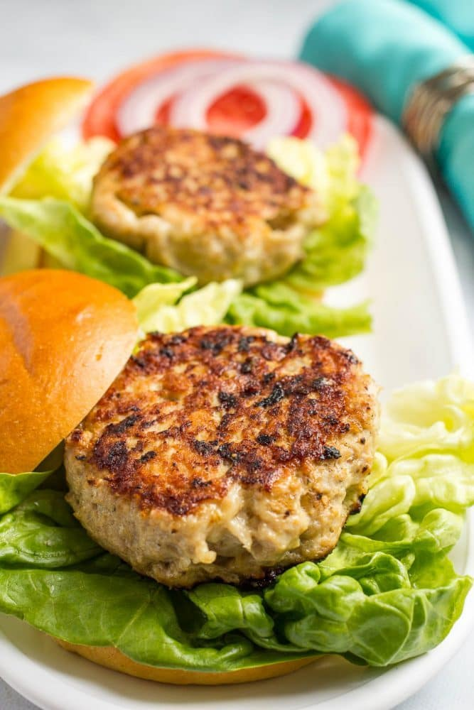 Cheddar chicken burgers served on buns with leafy lettuce