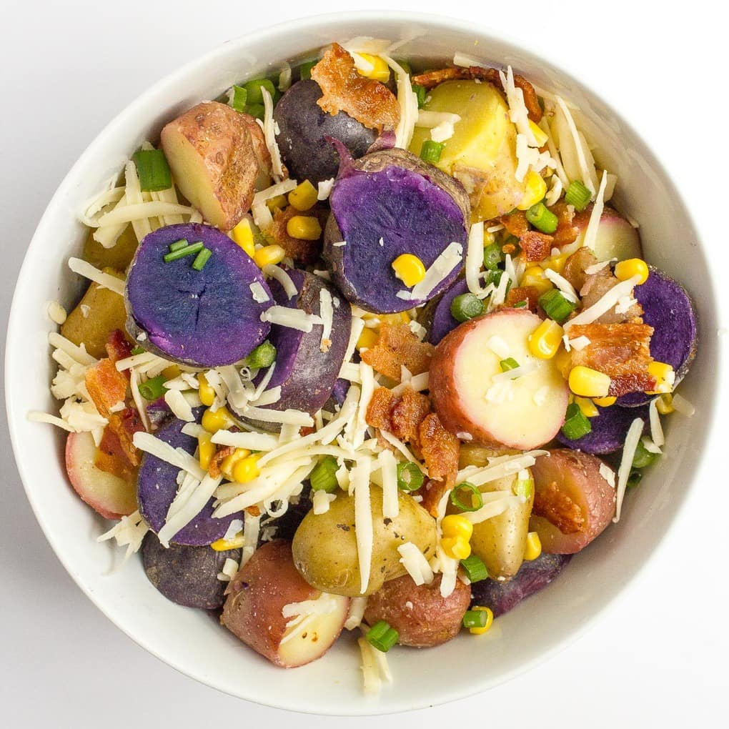 Cheddar corn and bacon potato salad with red, white and 'blue' potatoes