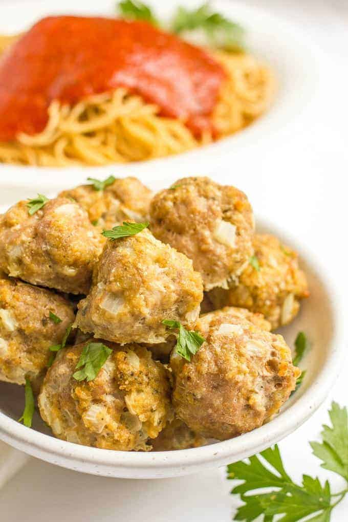 Homemade baked turkey meatballs are perfect for a spaghetti dinner, feeding a crowd or freezing to have on hand for busy nights. And this easy recipe takes just minutes to prep! | www.familyfoodonthetable.com