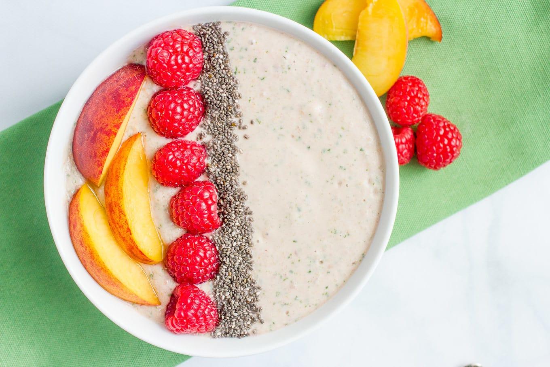 Peach, raspberry + spinach smoothie bowl
