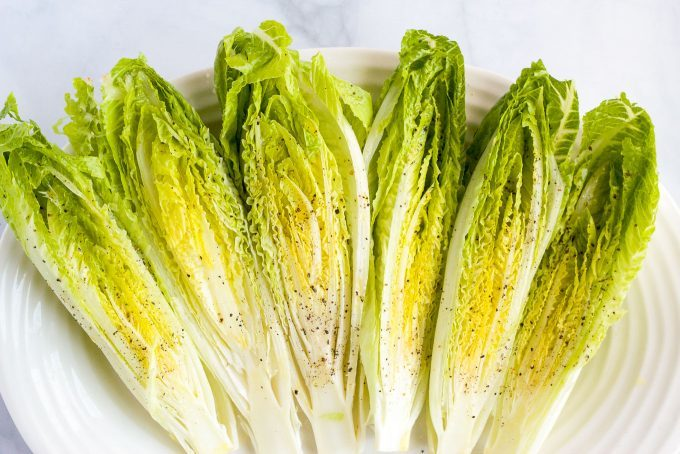 An array of seasoned strips of romaine lettuce