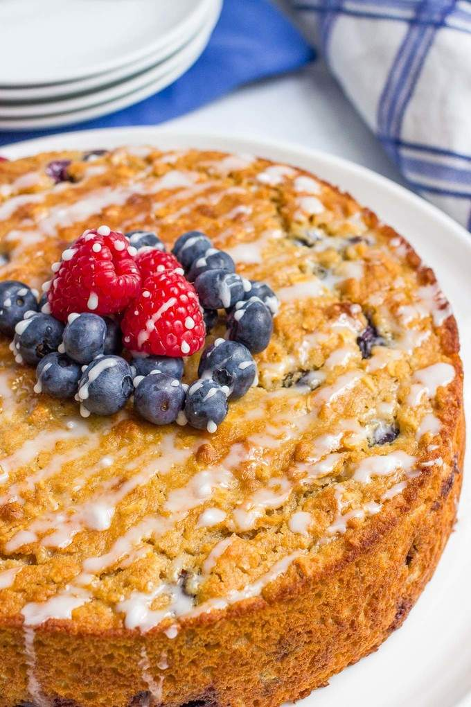 Blueberry cake with an easy lemon glaze - a healthy whole grain dessert with no butter or oil for a great, light summer treat!