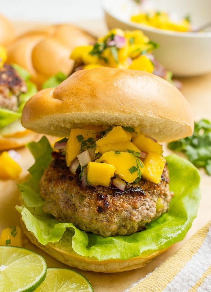 Spicy pork burgers with mango salsa - a delicious and easy summer dinner!   FamilyFoodontheTable.com