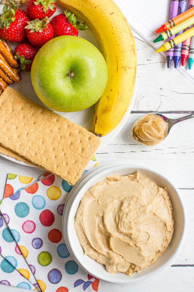 Creamy peanut butter yogurt dip - 5 ingredients and 5 minutes for this healthy kids snack. Serve with fresh fruit, graham crackers or pretzels