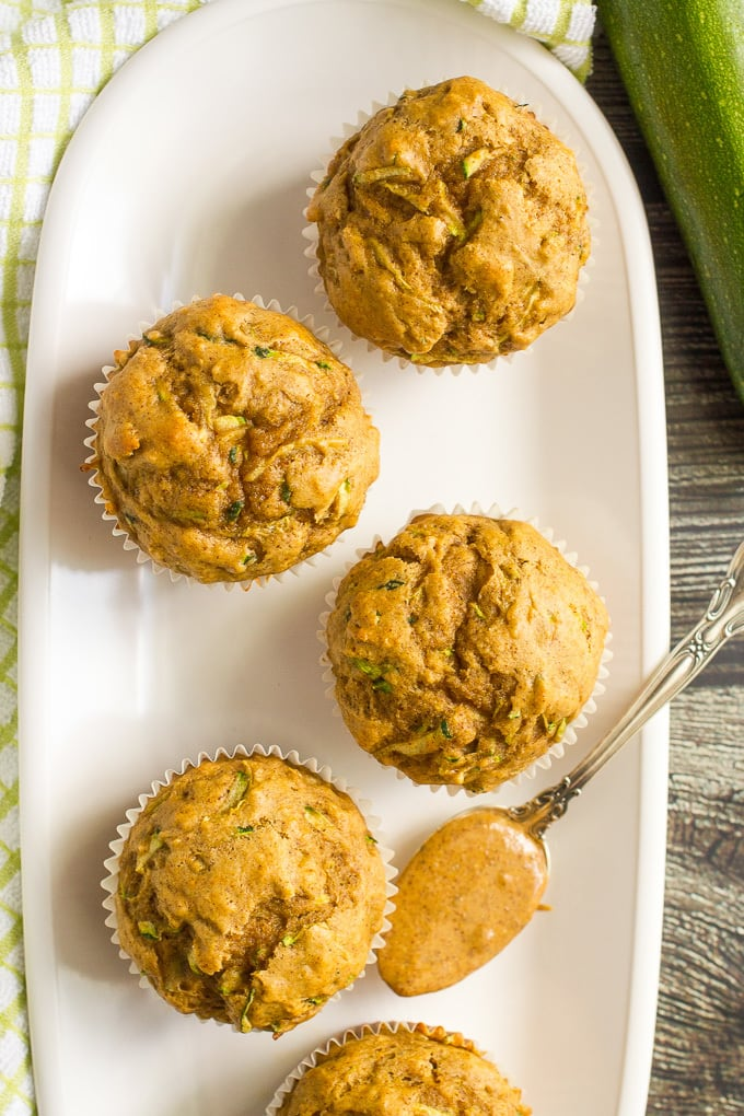 Whole wheat zucchini muffins with almond butter -- a delicious and protein-packed breakfast or school lunch option!