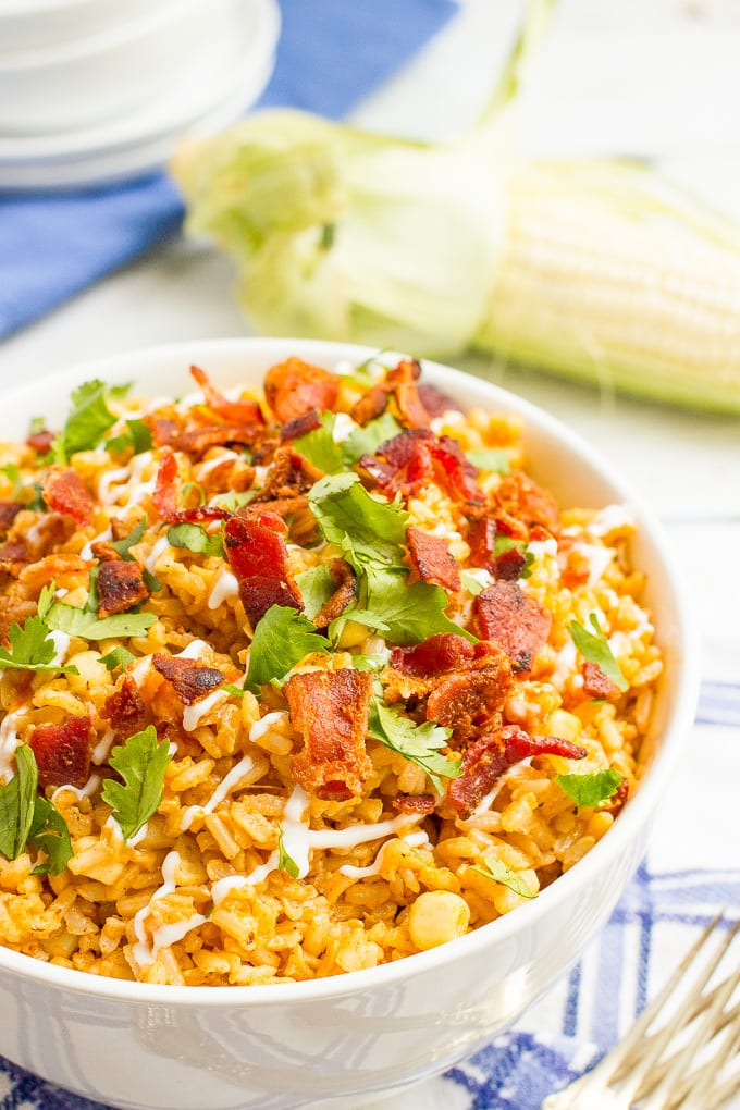 Bacon rice with corn is a summer side dish favorite that can be enjoyed year-round. Add your favorite toppings and dig in!