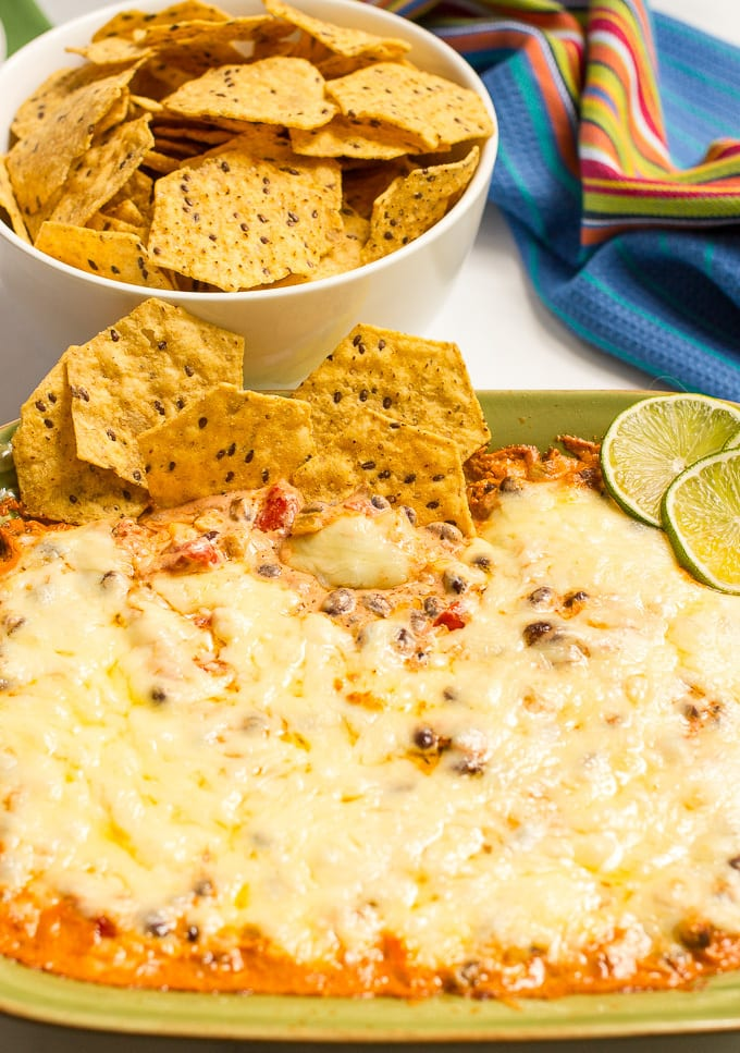 Cheesy baked black bean dip -- hot and bubbly and served with tortilla chips for an easy appetizer (great game day eats!)