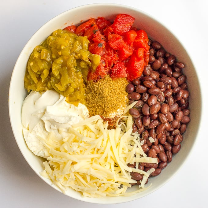 Black bean dip appetizer ingredients arranged in a large bowl