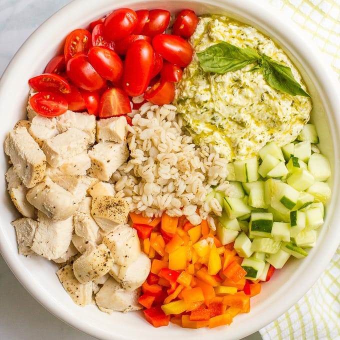 Chicken and barley salad with a creamy pesto-yogurt mixture — a great recipe for a fresh and healthy lunch or dinner! | familyfoodonthetable.com