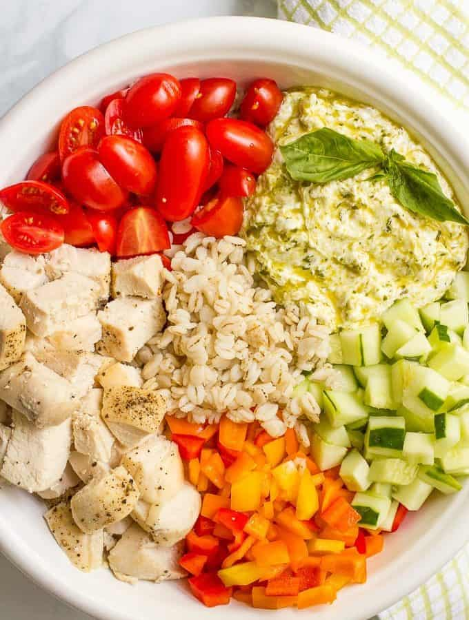 Cold barley salad with chicken and a creamy pesto-yogurt mixture — a great recipe for a fresh and healthy lunch or dinner! | familyfoodonthetable.com