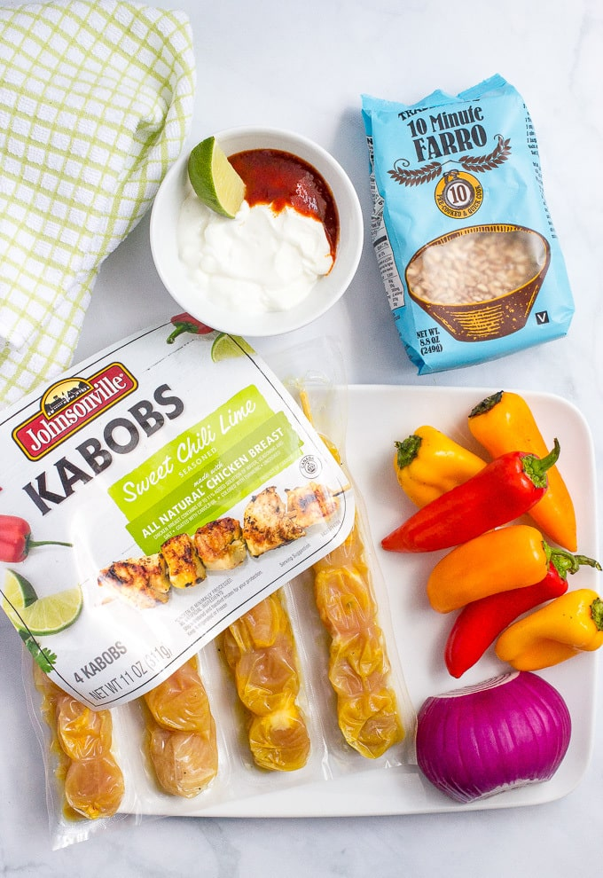 Grilled chili lime chicken kabobs with peppers, farro and a creamy adobo sauce