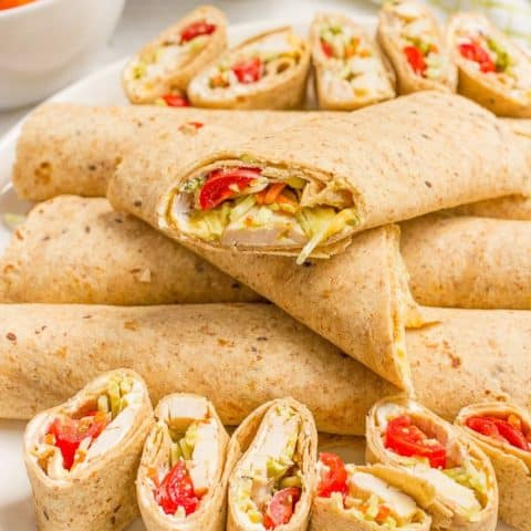 Easy chicken roll ups with cream cheese and veggies - great for lunch, appetizers or tailgating