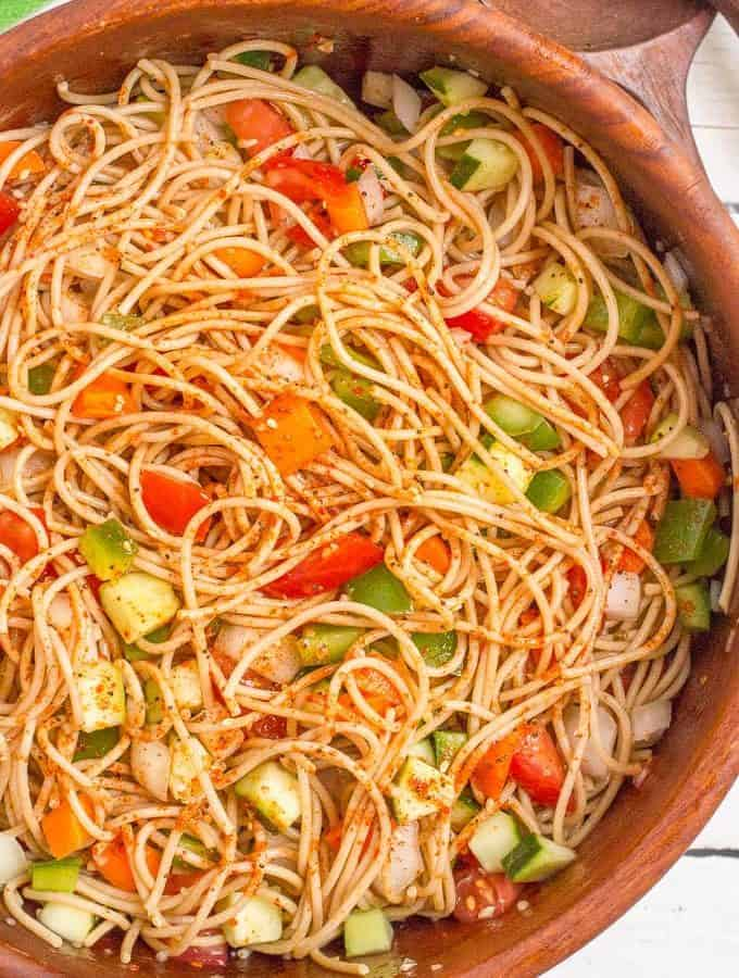 Classic spaghetti salad recipe with tomatoes, cucumber, green pepper, carrots and Italian dressing - perfect for sharing!