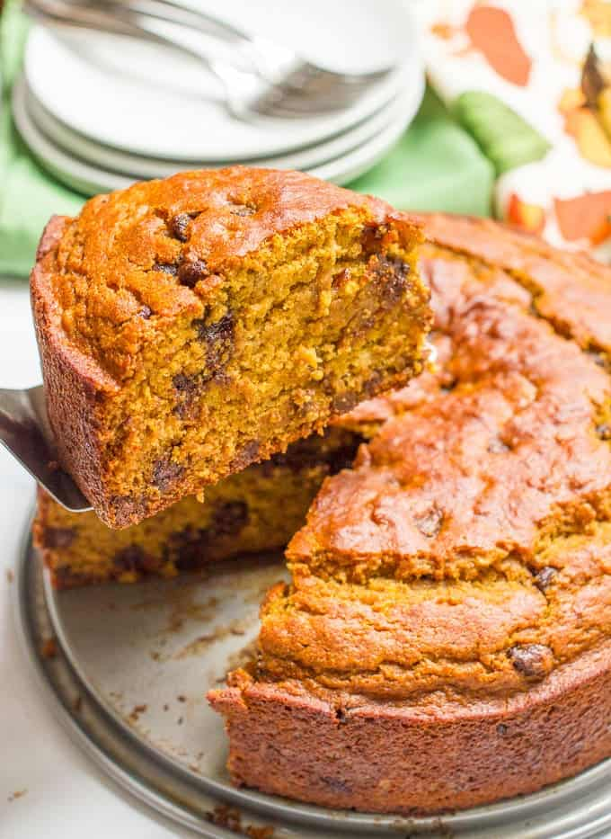 A slightly healthier banana pumpkin chocolate chip cake recipe with rich chocolate flavor and tall thick slices - a delicious fall dessert!