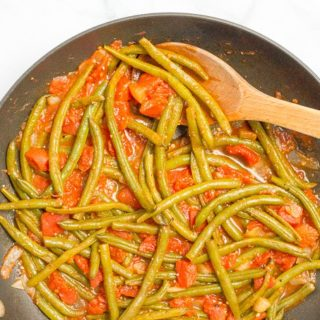 Sautéed green beans and tomatoes require just 4 ingredients and make for an easy, healthy and flavorful dinner side dish!