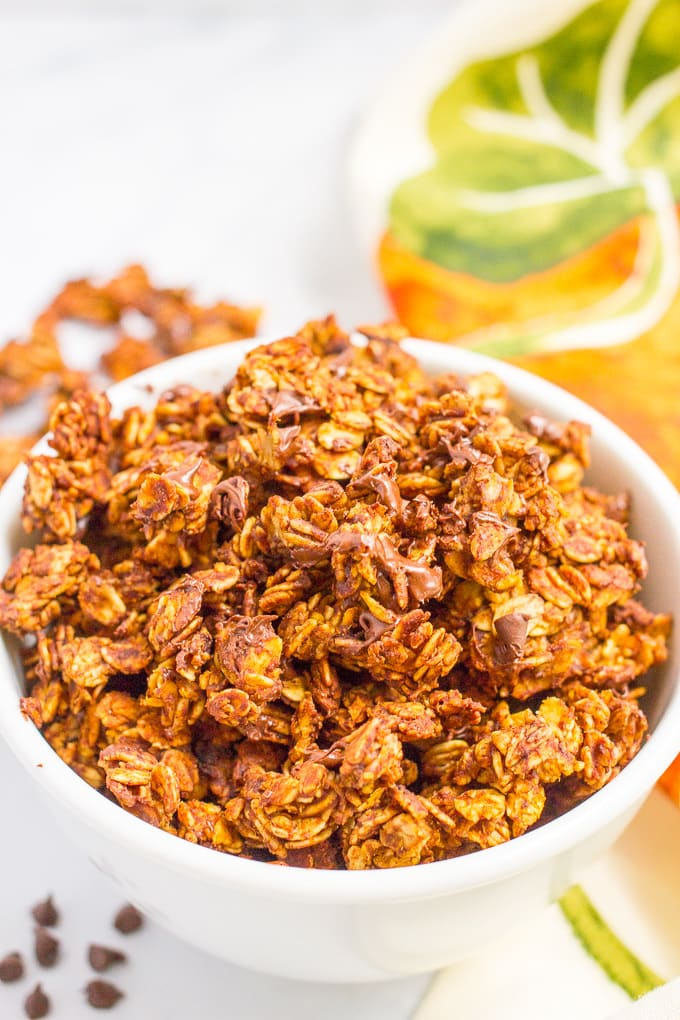 Chocolate pumpkin granola is an easy recipe you can make ahead and have on hand for a healthy breakfast or snacking. It's naturally gluten-free and vegan. #chocolate #pumpkin #granola #breakfast #snack