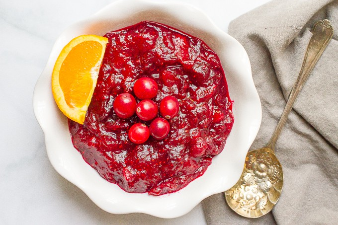 Easy cranberry sauce -- just 15 minutes and 4 ingredients for this homemade cranberry sauce with orange zest and honey that give it a great depth of flavor! | www.familyfoodonthetable.com
