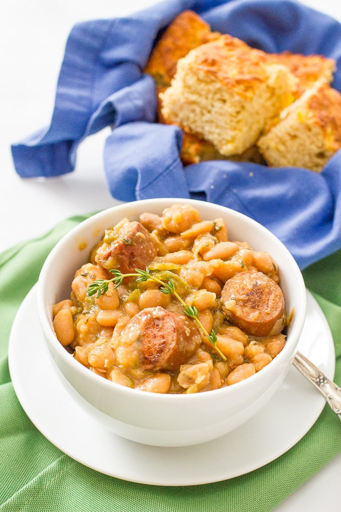 Slow cooker white beans and sausage is a delicious and easy dinner recipe with creamy beans, smoked turkey sausage and fresh herbs.