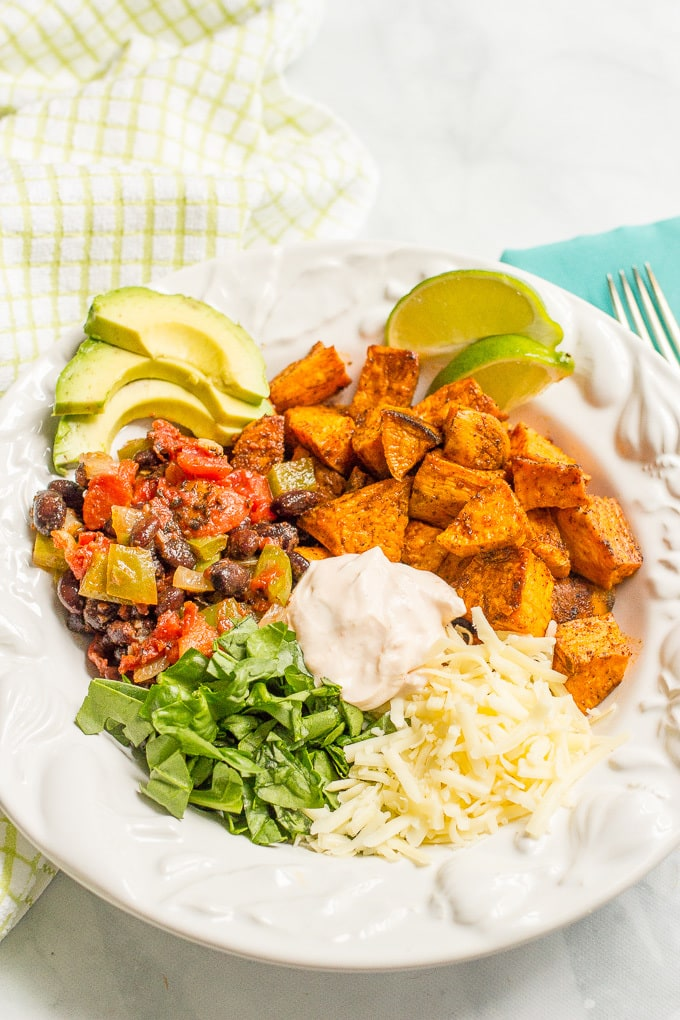 Taco-flavored vegetarian power bowls with sweet potatoes, black beans and a spiced yogurt sauce - an easy, healthy vegetarian dinner!