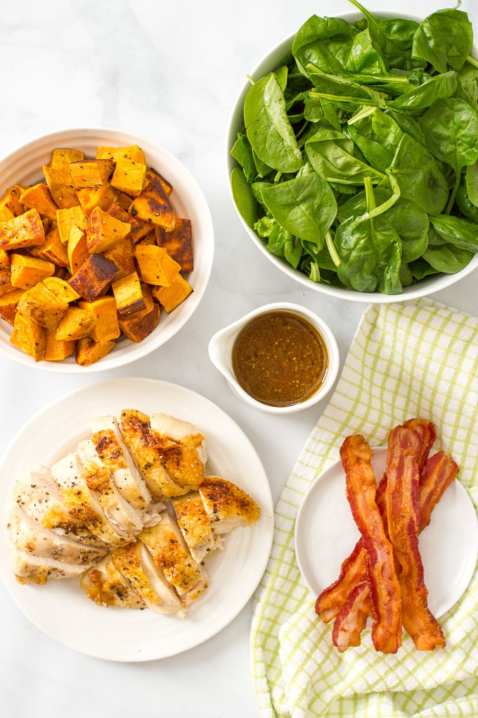 Warm chicken, spinach and sweet potato salad with bacon vinaigrette -- a healthy, hearty main dish salad with big bacon flavor! | www.familyfoodonthetable.com