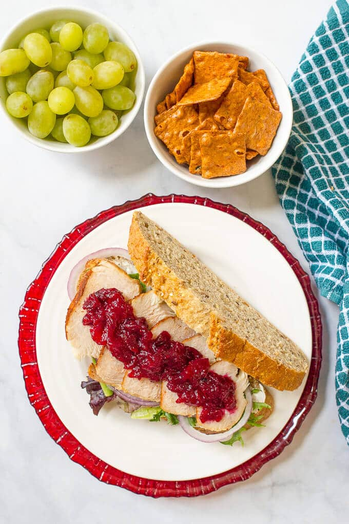 An easy turkey cranberry cream cheese sandwich with greens and red onion that's the perfect way to use up leftover Thanksgiving turkey!