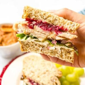 Leftover Thanksgiving turkey sandwiches with cream cheese, cranberry sauce, greens and red onion - a delicious easy lunch! | www.familyfoodonthetable.com