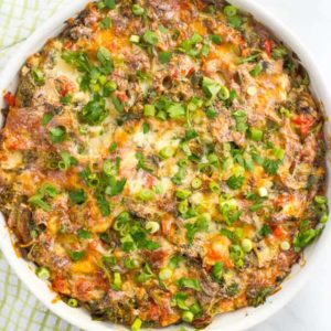 Make-ahead healthy turkey sausage breakfast casserole is an easy, veggie-packed, lightened up version of your favorite breakfast casserole! Great for Christmas morning! | www.familyfoodonthetable.com
