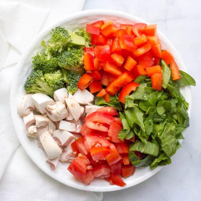 A bowl full of chopped fresh veggies