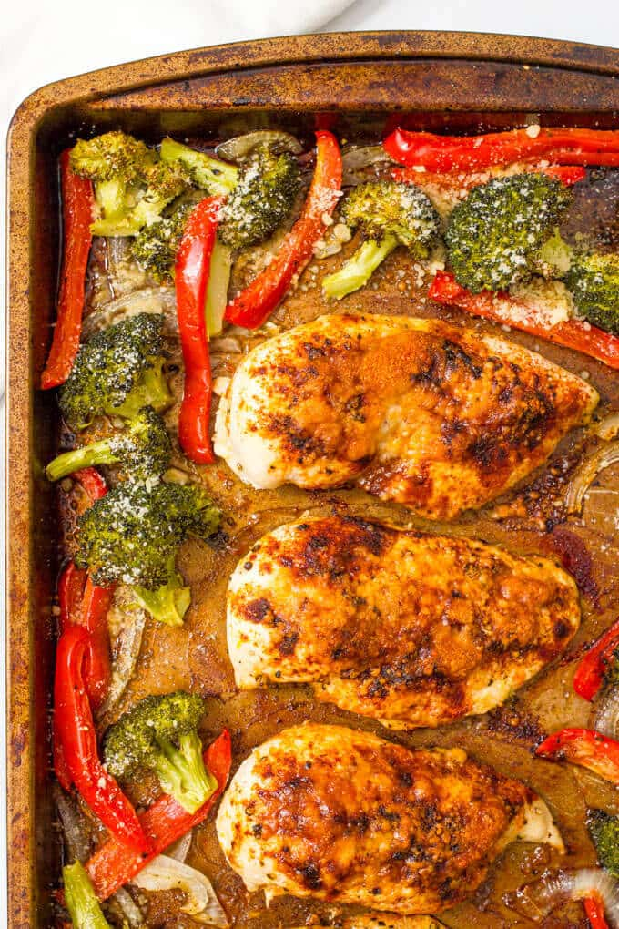 Parmesan sheet pan chicken and broccoli with bell peppers makes for an easy, hands-off healthy dinner! | www.familyfoodonthetable.com