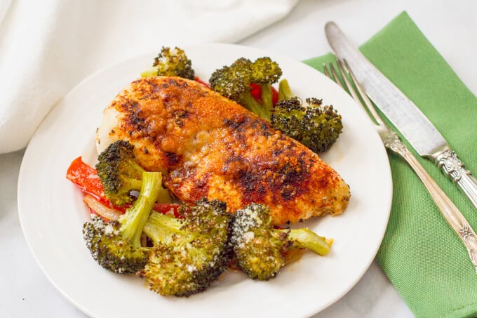 Parmesan sheet pan chicken and broccoli with bell peppers | www.familyfoodonthetable.com