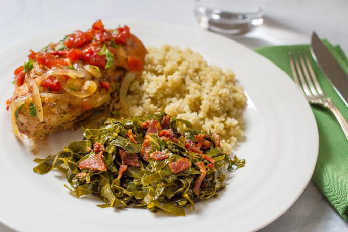 Southern collard greens and bacon served with chicken and rice