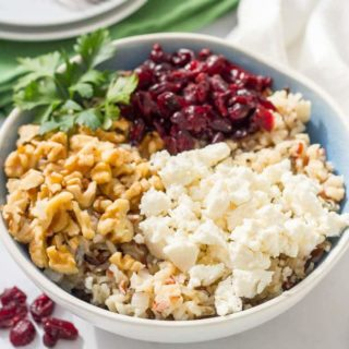 Warm wild rice salad with cranberries, pecans and goat cheese is a delicious combination of flavors and textures - perfect for a holiday side dish! | www.familyfoodonthetable.com