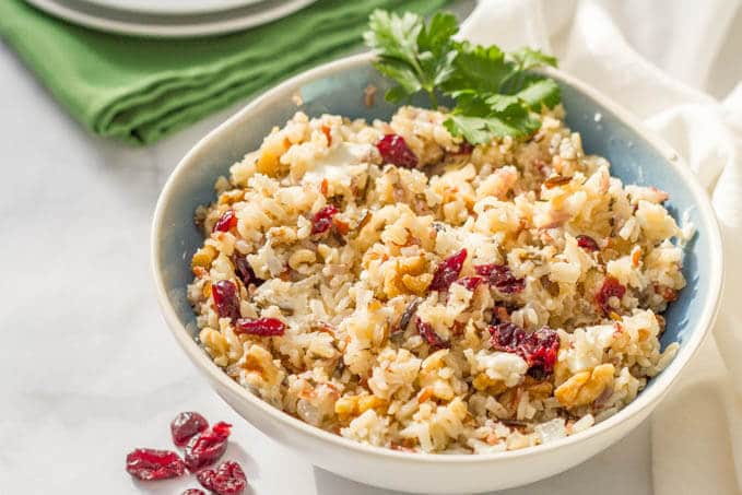 Warm wild rice salad with dried cranberries, pecans and goat cheese