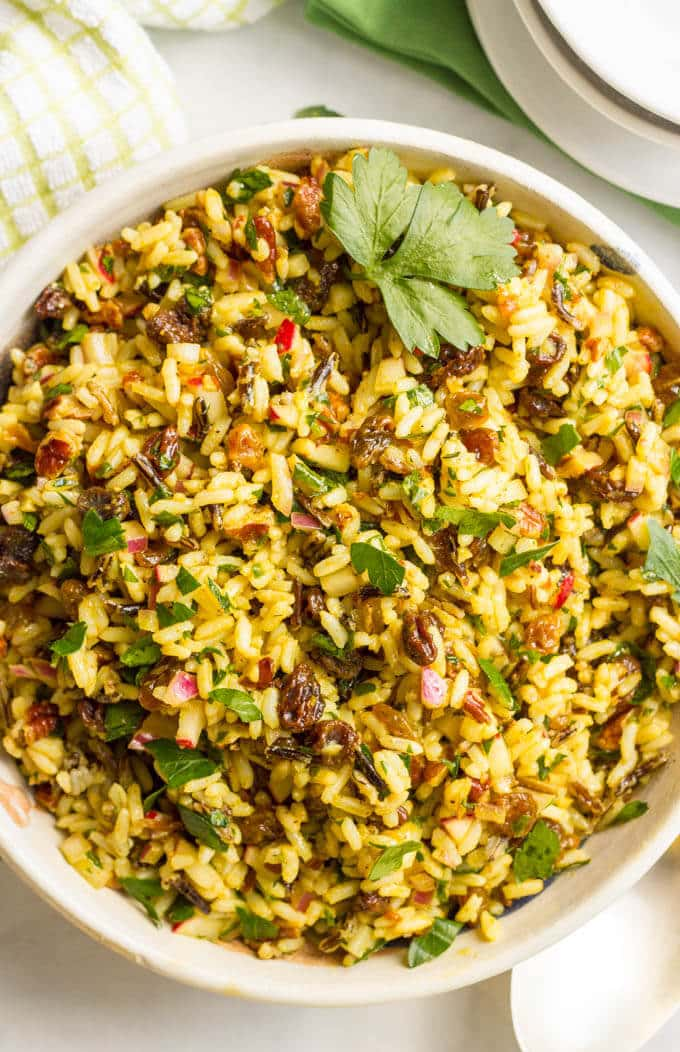 This cold curried wild rice salad with raisins and pecans has amazing flavors and textures and is perfect as a make-ahead dinner side dish or lunch. You'll be addicted!