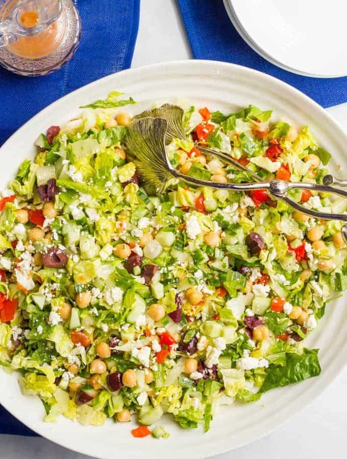 Mediterranean chopped salad is a crunchy, flavorful salad with chick peas, olives and feta cheese - perfect for a vegetarian and gluten-free lunch or light dinner!
