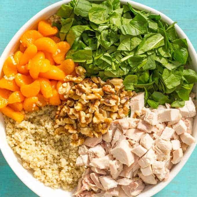Quinoa chicken spinach salad with mandarin oranges, walnuts and a honey-lime vinaigrette -- a flavorful main dish salad that's ready in just 20 minutes! | www.familyfoodonthetable.com