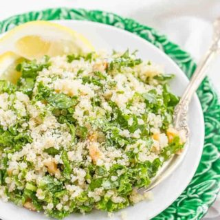 Kale quinoa salad with chopped walnuts, grated Parmesan cheese and a white wine vinaigrette is a light, fresh and healthy side dish! | www.familyfoodonthetable.com