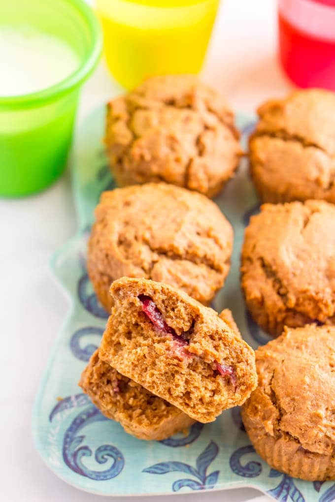 Healthy peanut butter and jelly muffins are whole wheat and naturally sweetened - a fun kids breakfast, snack or school lunch addition! | www.familyfoodonthetable.com
