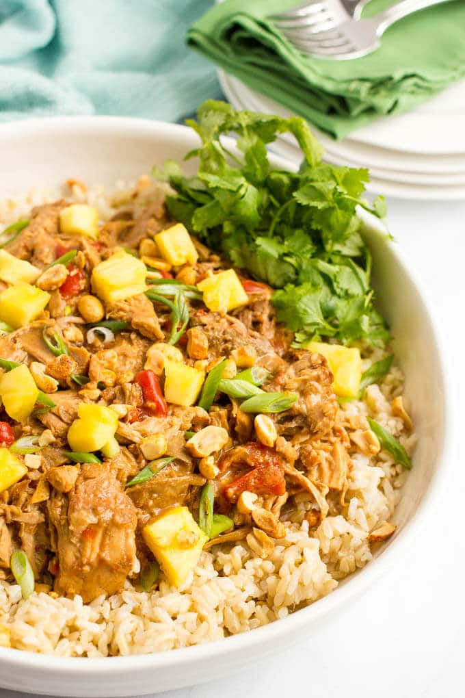 Slow cooker Thai pork takes just a few minutes to prep and comes out with tender chunks of pork and a rich, delicious peanut sauce! | www.familyfoodonthetable.com