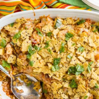 Healthy chicken taco casserole with brown rice is an easy weeknight dinner with a cheese and crunchy tortilla chip topping! | www.familyfoodonthetable.com